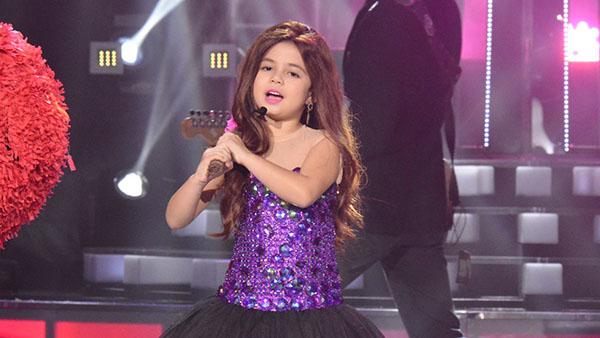 Xia Vigor impersonates Selena Gomez on Your Face Sounds Familiar Kids