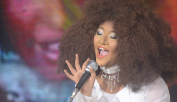Elha Nympha impersonates Chaka Khan on Your Face Sounds Familiar Kids through the fire.jpg