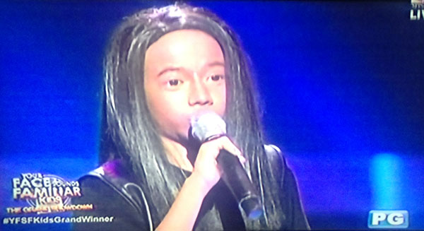 Justin Alva as Arnel Pineda on Your Face Sounds Familiar Kids Grand Final Showdown