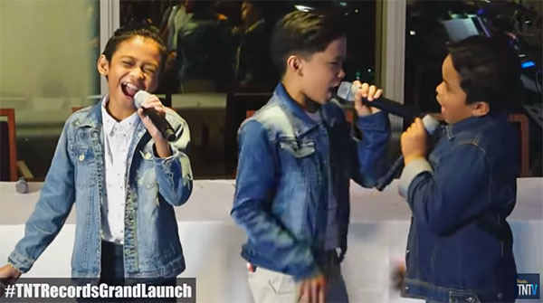 "TNT Boys signs deal with TNT Records, sings ""Flashlight"" Live"